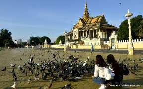 Tourists with pigeons at a square in front of the Royal Palace, Phnom Penh, Cambodia