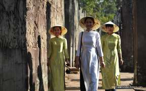 Vietnamese woman wearing the Ao Dai at Angkor Wat temple