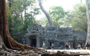 Tourists on an ride elephant tour at Bayon temple in Angkor Thom