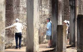 Tourists are visiting the Angkor Wat temple