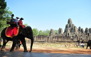 Riding elephants in Banteay Srei