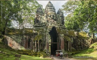 The main transport Tuk Tuk at northern gate of Angkor Thom in Siem Reap of Cambodia