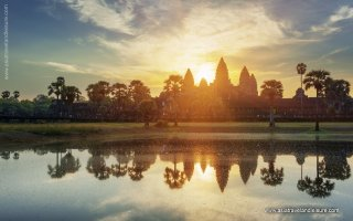 Mysterious towers of ancient temple complex Angkor Wat at sunrise