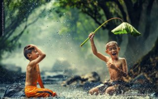 Children are playing in the Cambodia river