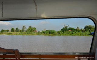 View to river bank from speed boat